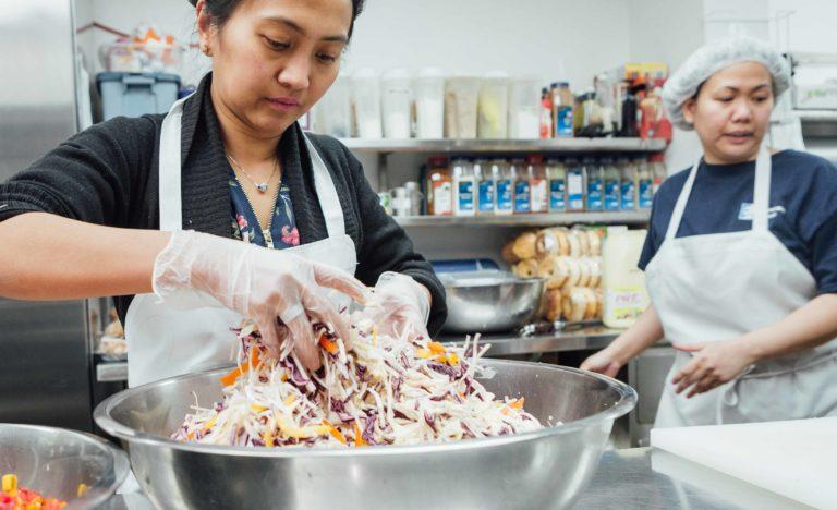 Covenant House Toronto kitchen staff Maria preparing food