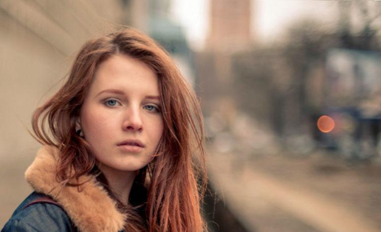A teenage girl looking sad.