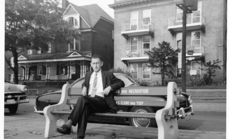 Covenant House donor Alfred Taylor sitting on a bench wearing a suit