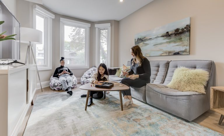 Three young girls sitting in the living room of the Avdell Home