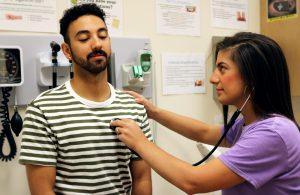 Elisa assisting a male patient