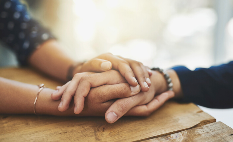 A hand being held with compassion