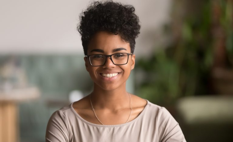 Young girl with short hair and glasses