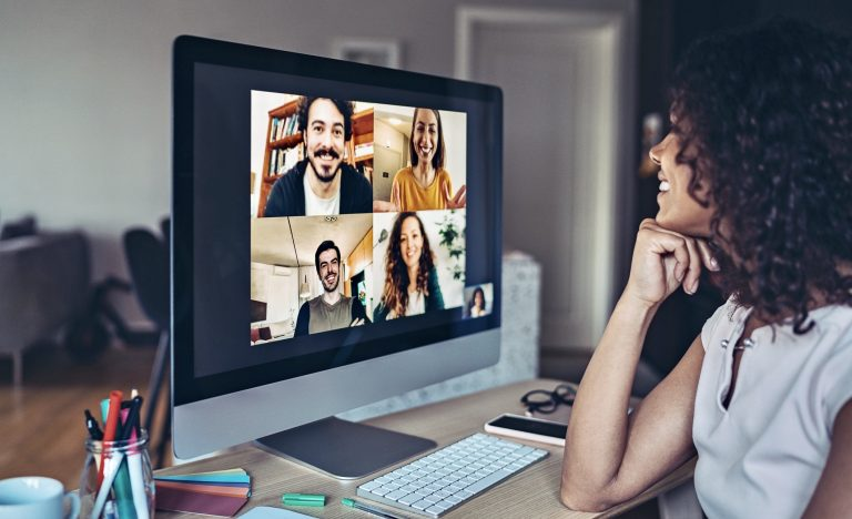 Young woman virtually interacting with colleagues.